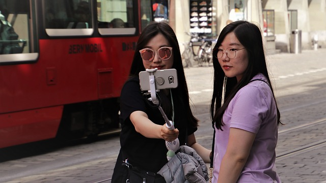 Tourists taking selfies